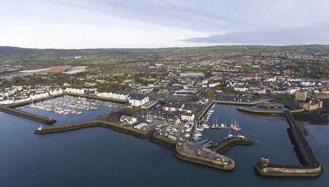 An aerial view of Carrickfergus marina (left) the sailing club (centre) and the town Harbour on the right in County Antrim