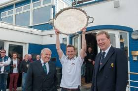 Supreme champion. 2016 winner Alex Barry holds aloft the historic silver salver with ISA President David Lovegrove (left) and RCYC Admiral John Roche.